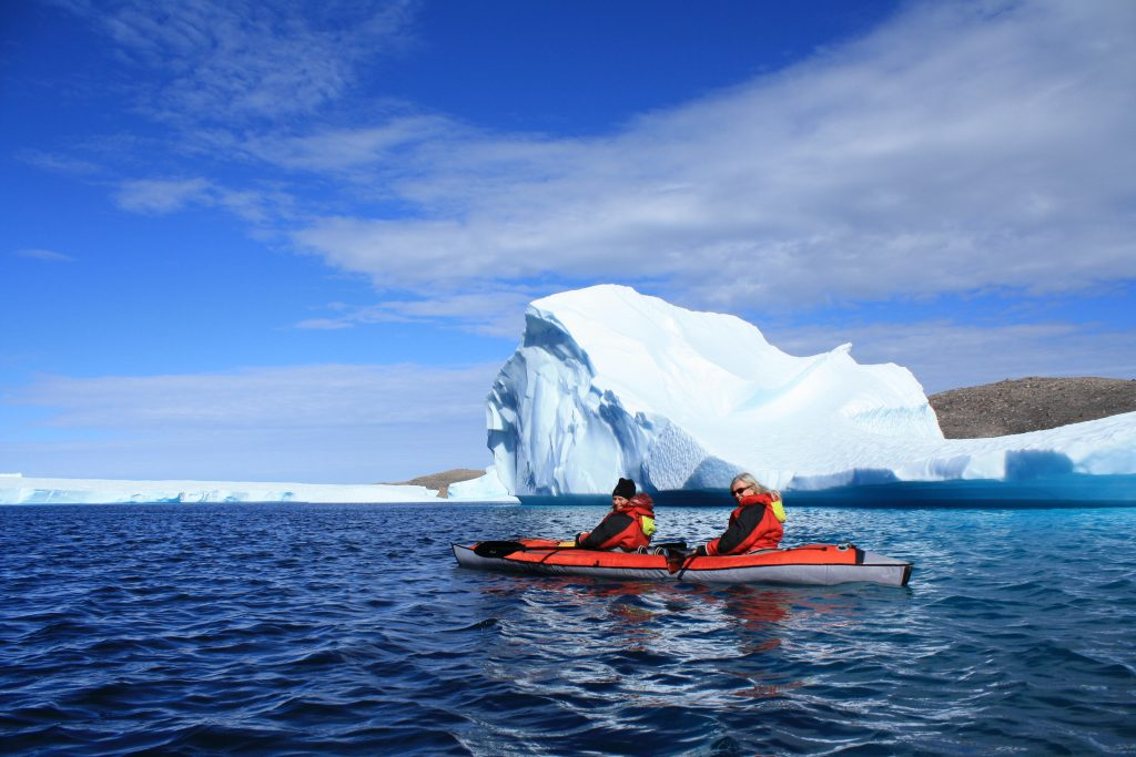 Kayaking among icebergs, taken while traveling in Nunavut