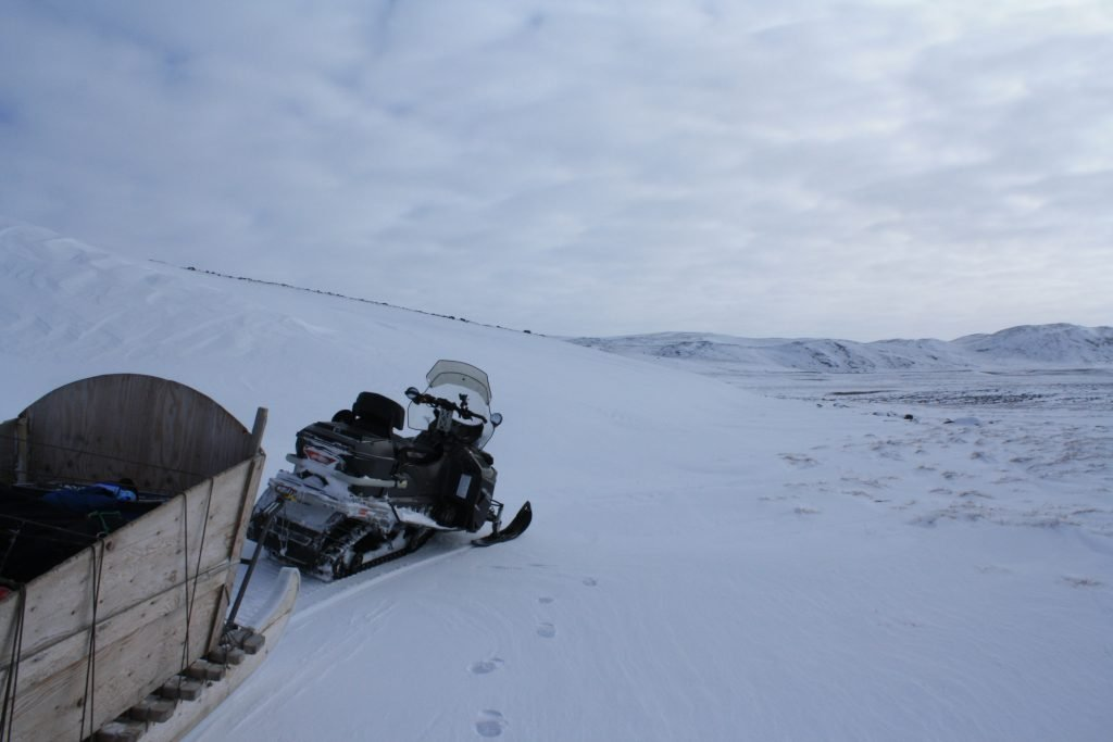Snowmobiling on the tundra outside of Iqaluit, Nunavut