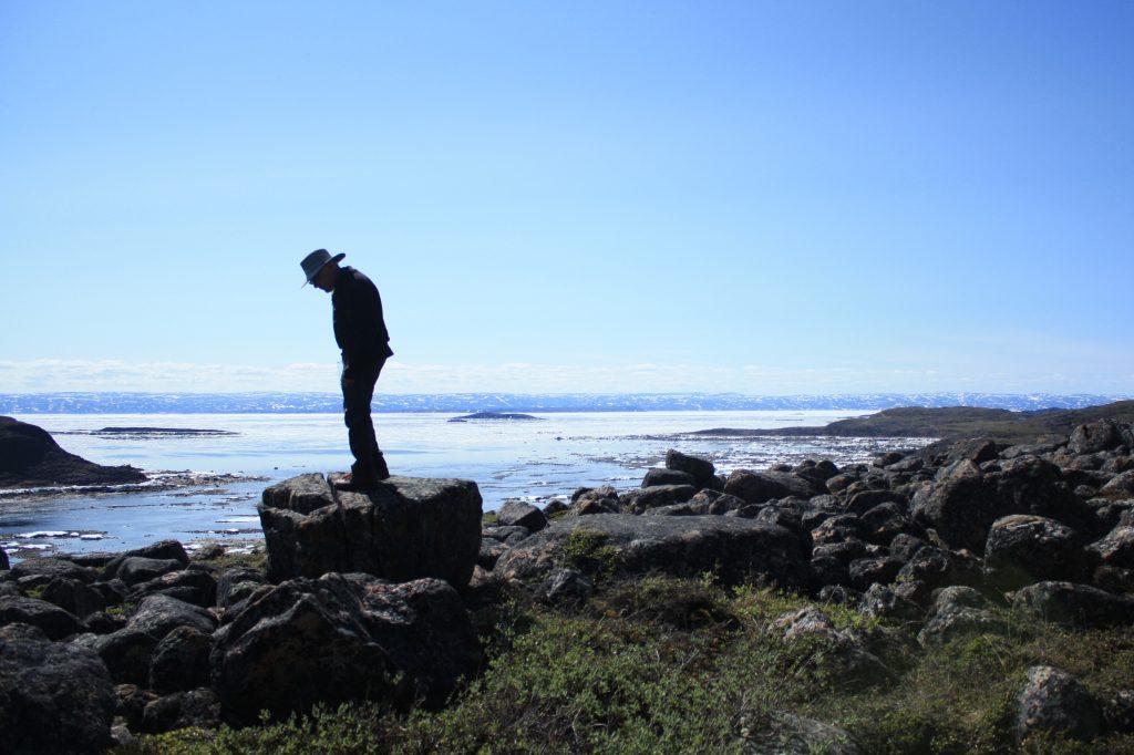 Sole hiker at Ward's Inlet, near Iqaluit Nunavut