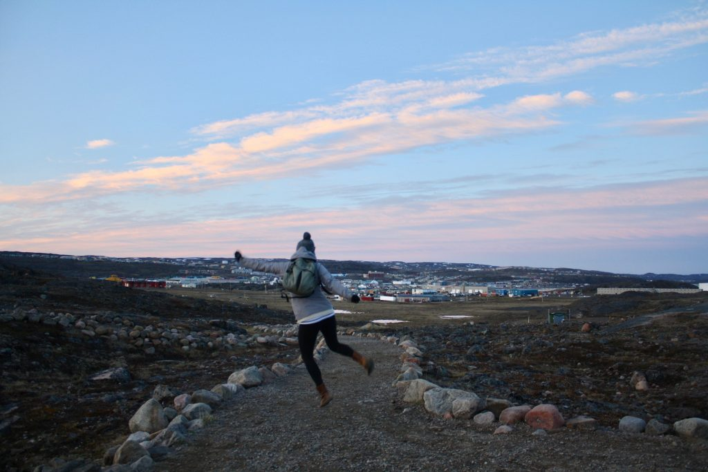 Jumping in the air at Sylvia Grinnell Park in Iqaluit, Nunavut