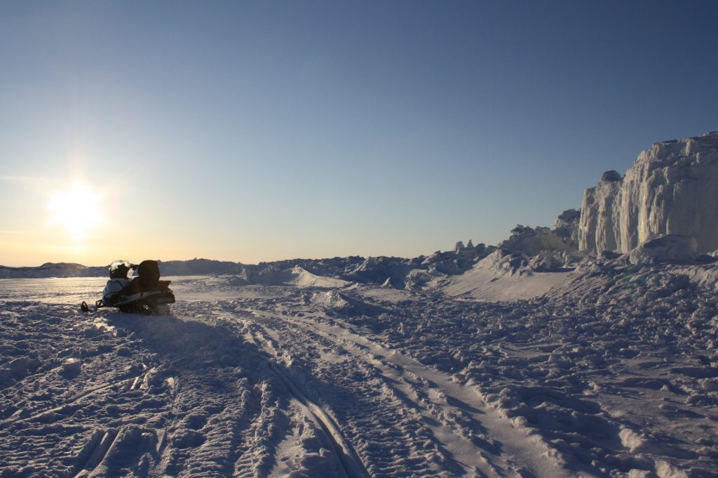 Snowmobiling on the arctic ocean, outside Iqaluit Nunavut