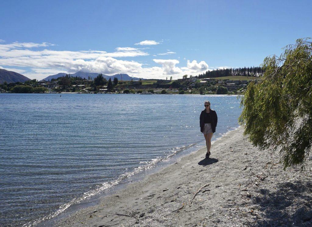 Walking along beach of Lake Wanaka