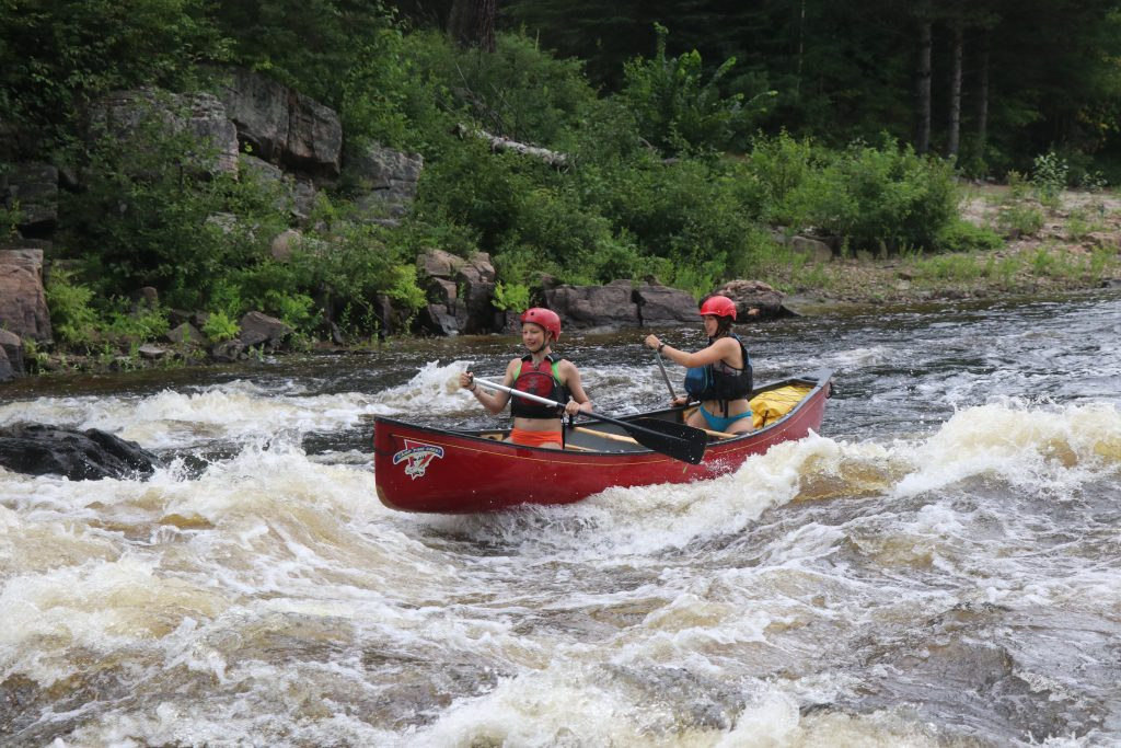 Canoe guiding whitewater