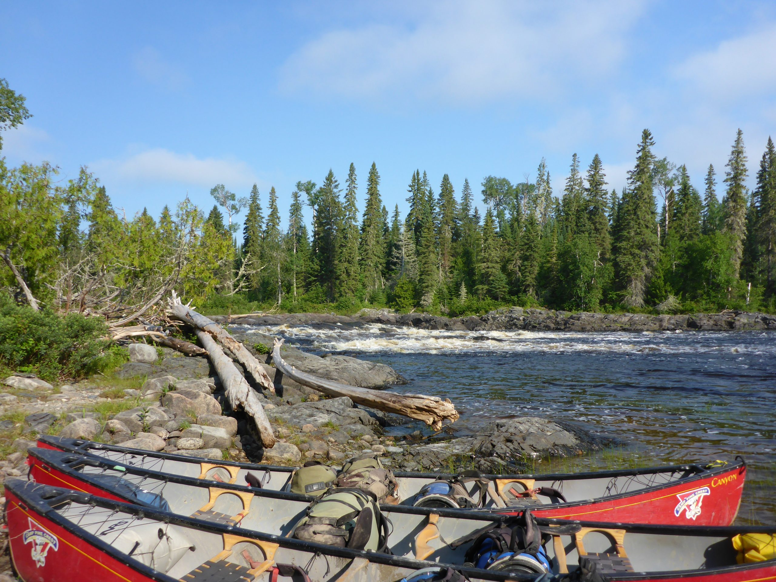 Loaded Canoes before a Portage