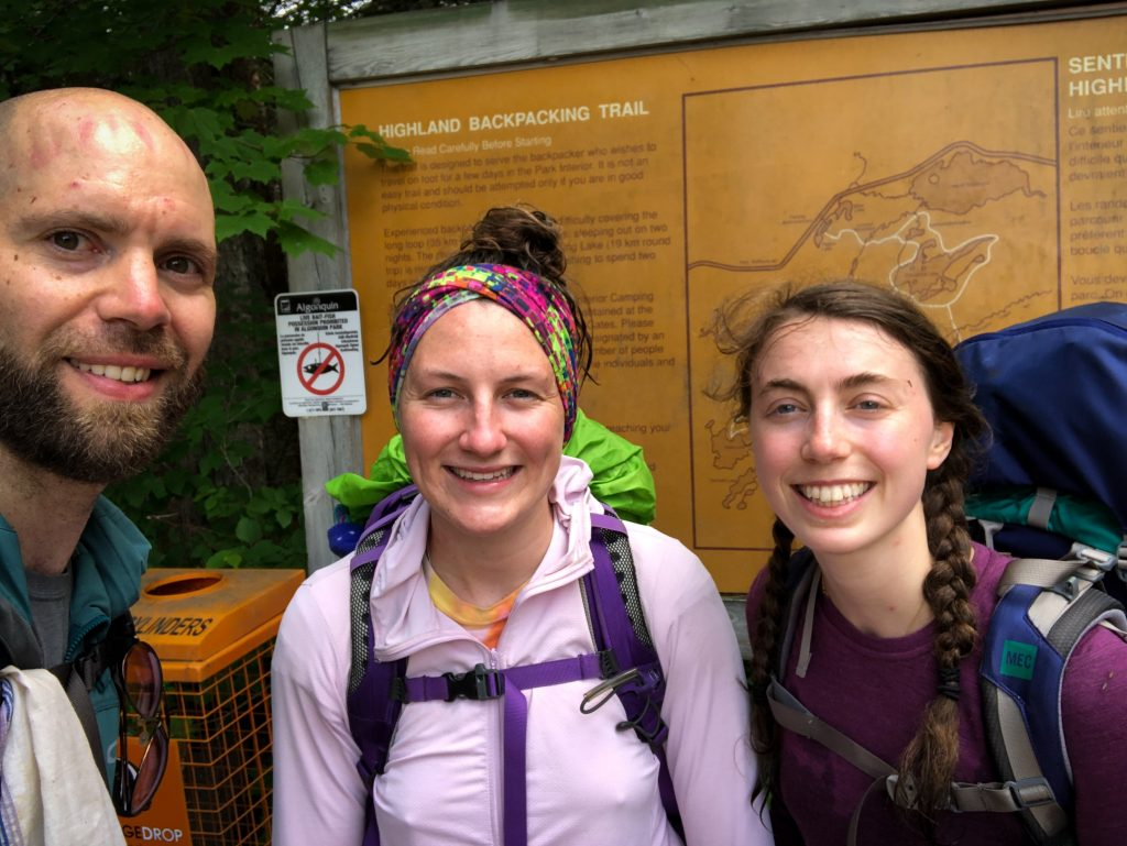 Selfie of three hikers just completed Highland Backpacking Trail