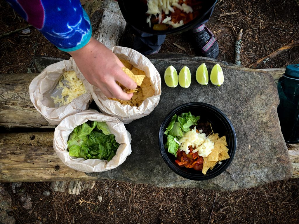 Making taco bowls for dinner at the campsite
