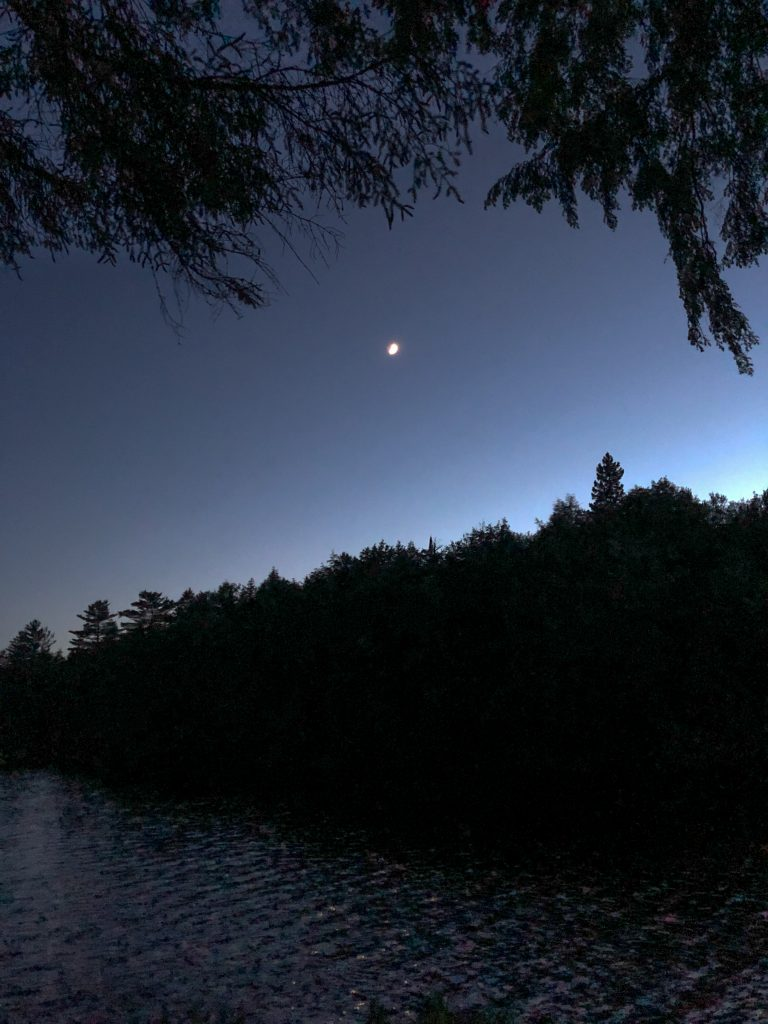 Moon in the sky at Provoking Lake in Algonquin