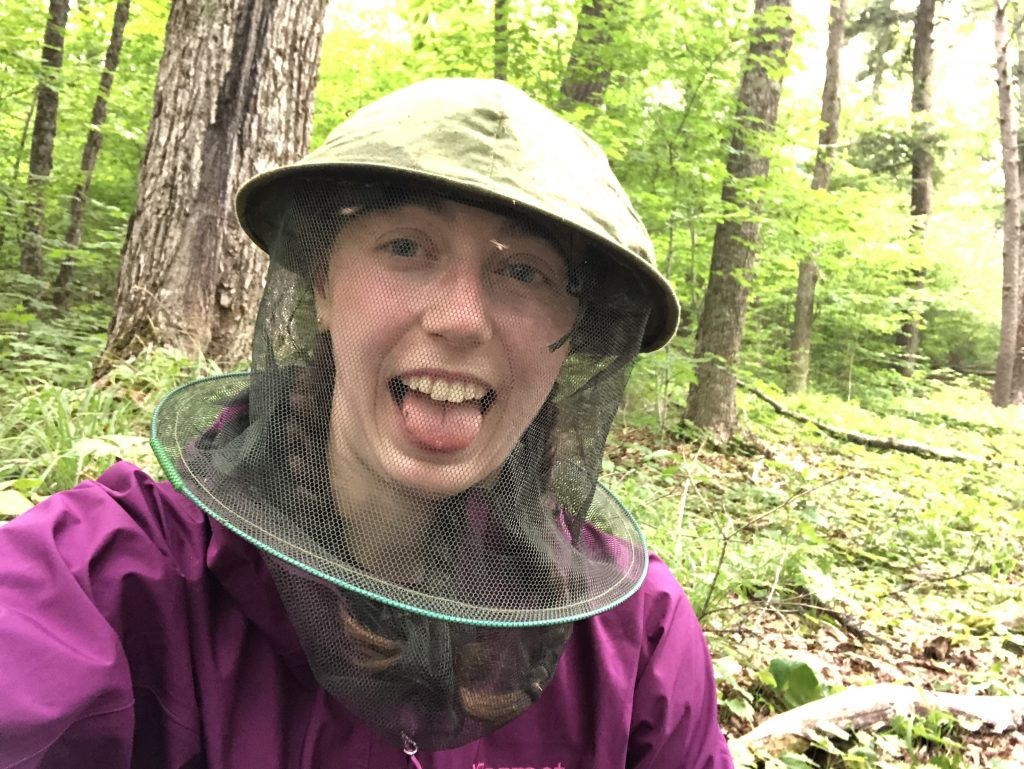 Mikaela wearing a green bug hat, which was essential on the Highland Backpacking Trail